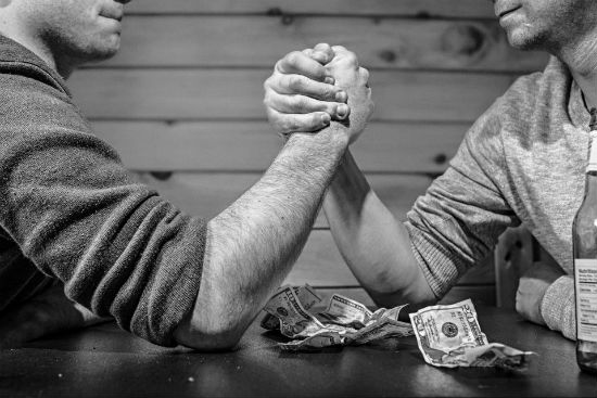 money-men-arms-table-black-white.jpg